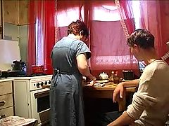 Mom And Boy In The Kitchen