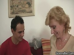 Blonde Granny Jumps On His Cock
