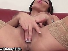 Mature Lady With Big Fake Tits Loves To Please Her Own