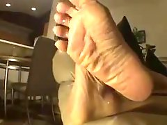 Mature Wrinkled Soles On The Sofa