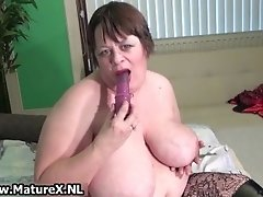 Old Busty Woman Is Licking Violet Dildo And Then Puts I