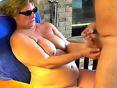 Granny Head 23 Sitting On The Chair While Giving A Bj