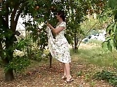 Mature MILF Takes Younger Slut S Top Off And Sucks Her Tits Outside