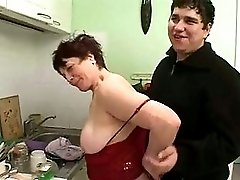 Plump Woman With Saggy Boobs And Guy